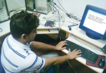 A-man-working-on-kernel-proting-with-desktop