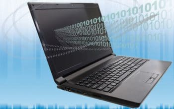 laptop with binary code